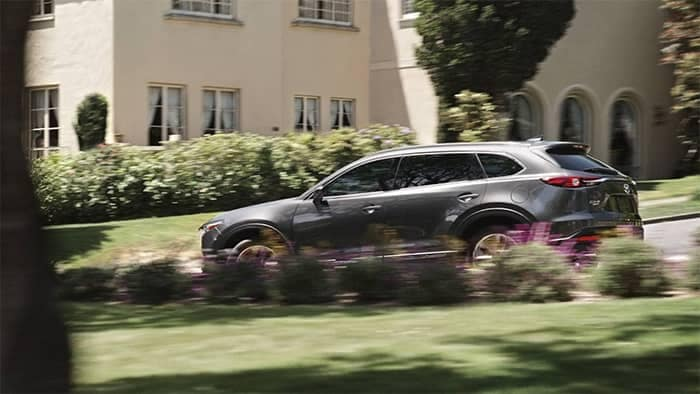 Mazda CX-9 Driving Through a Neighborhood