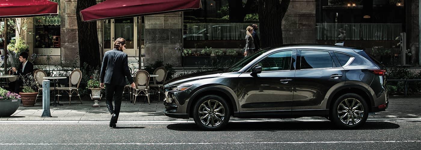 Man walking to Mazda CX-5