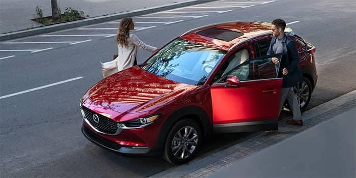 Couple getting into a 2020 Mazda CX-30
