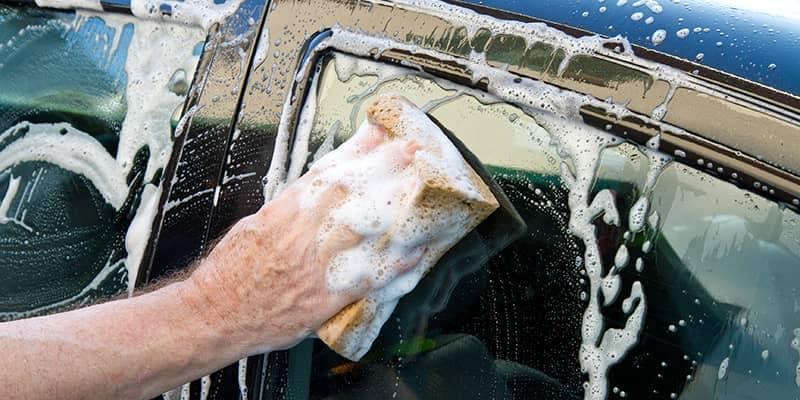 Person handwashing car