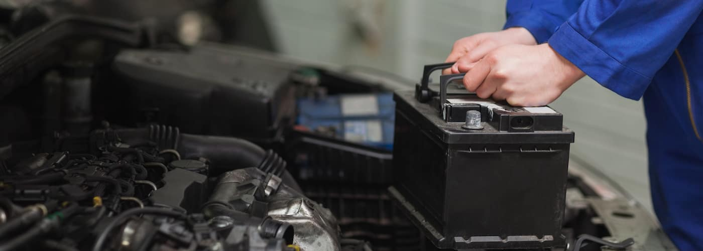 Mechanic Removing Car Battery