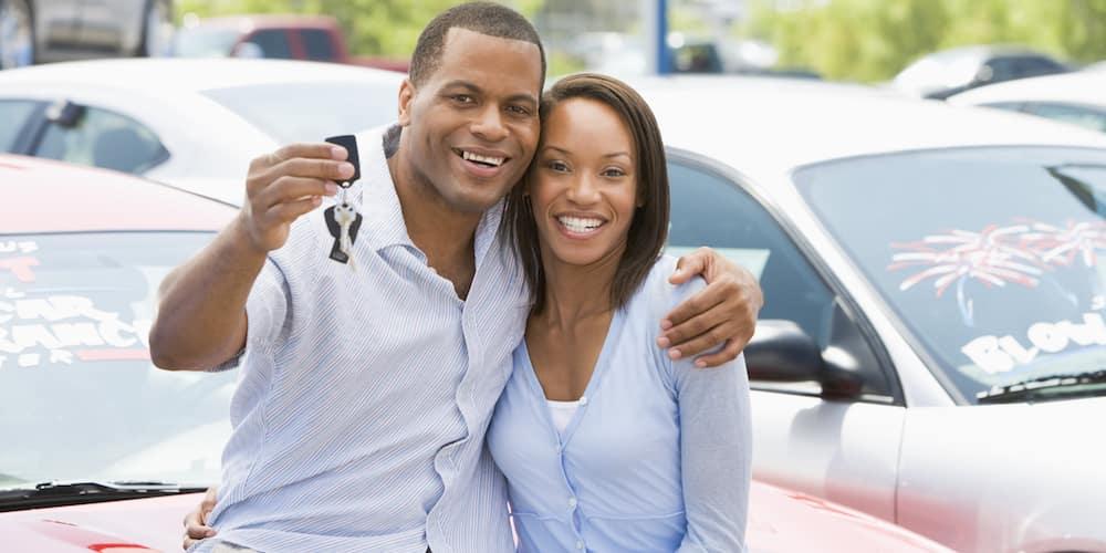 Couple Holding Car Keys