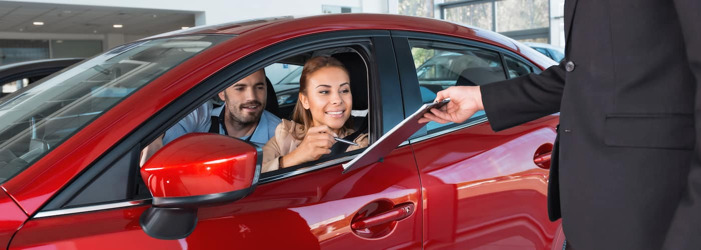 couple trading in financed car