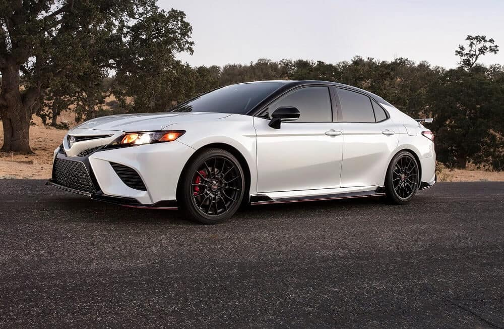 White Toyota Camry Driving