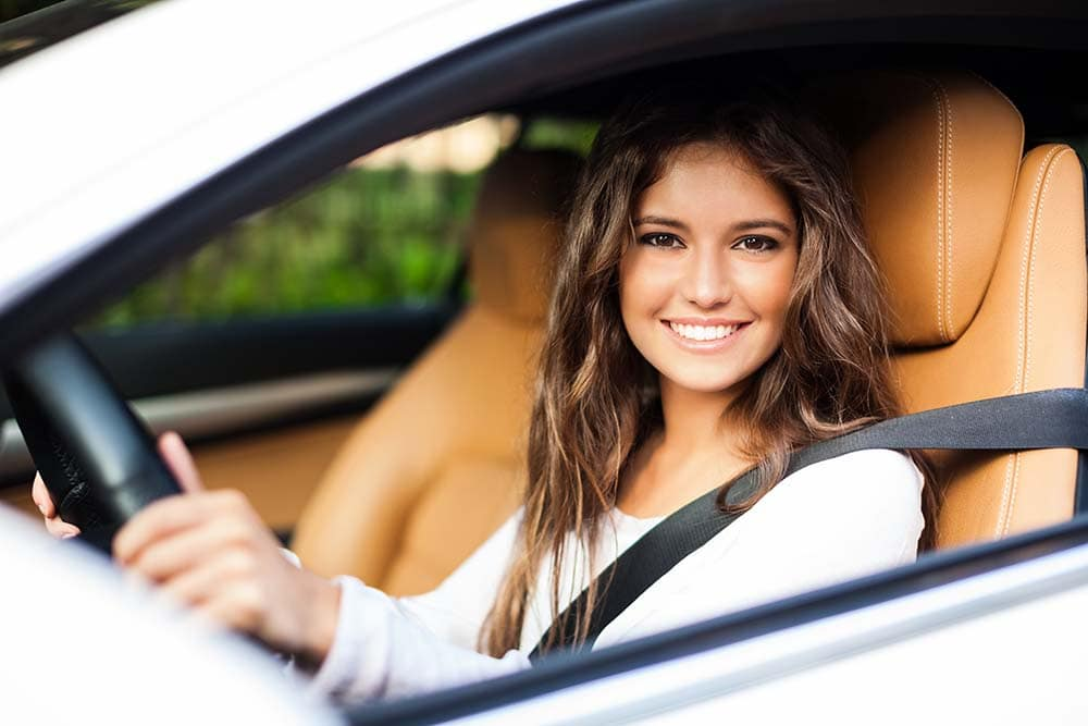 Girl in car ready to drive