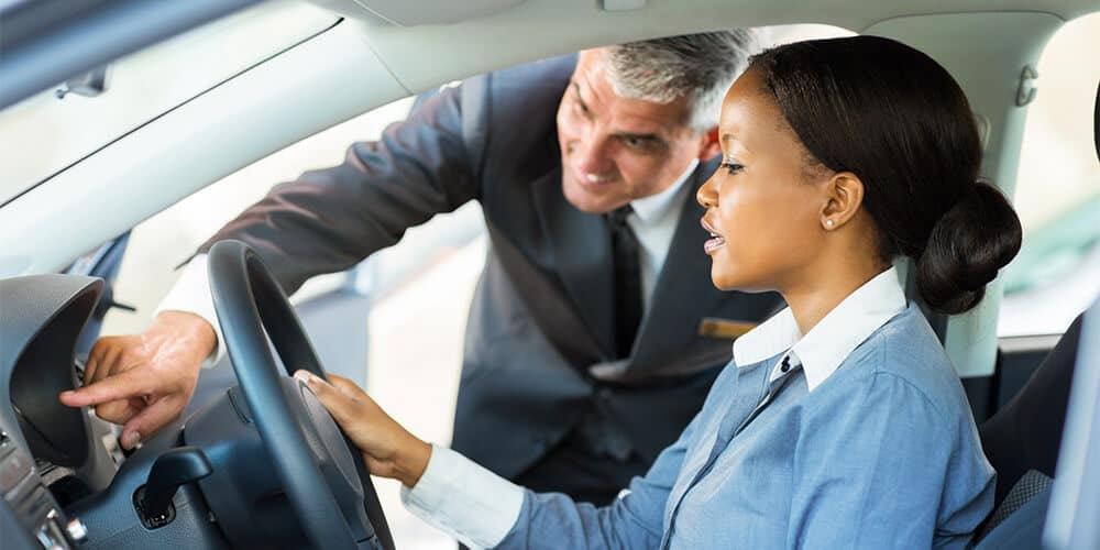 Woman Test Driving A Car