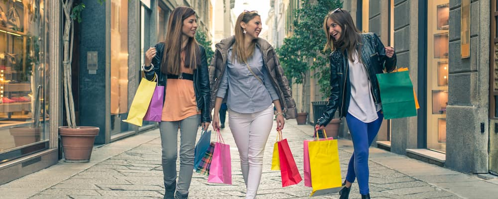 Ladies with shopping bags in outdoor mall