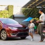 Family walking towards Chrysler Pacifica minivan
