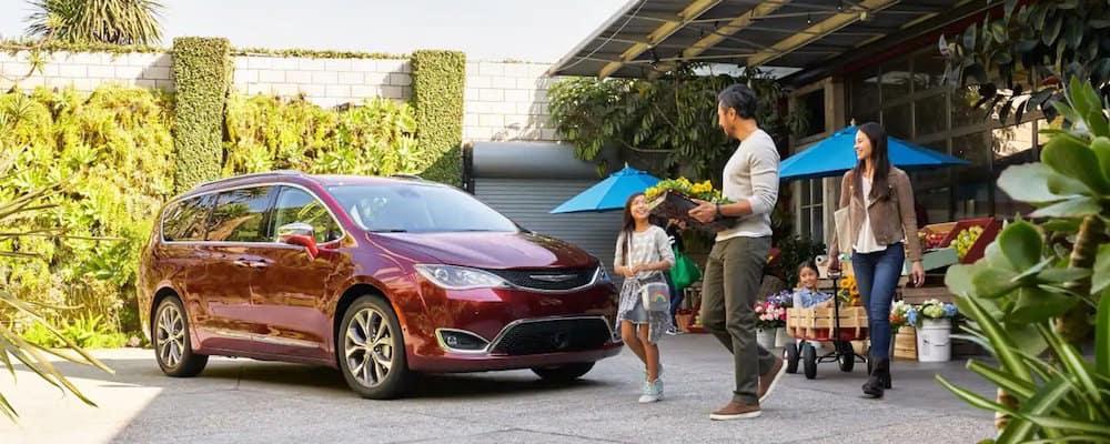 Family walking towards Chrysler Pacifica minivan