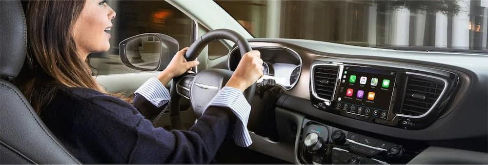 Woman driving while using Apple CarPlay
