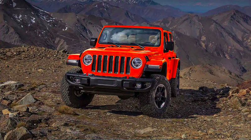 Red Wrangler parked on a mountain