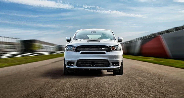 2019 Dodge Durango in silver driving down track