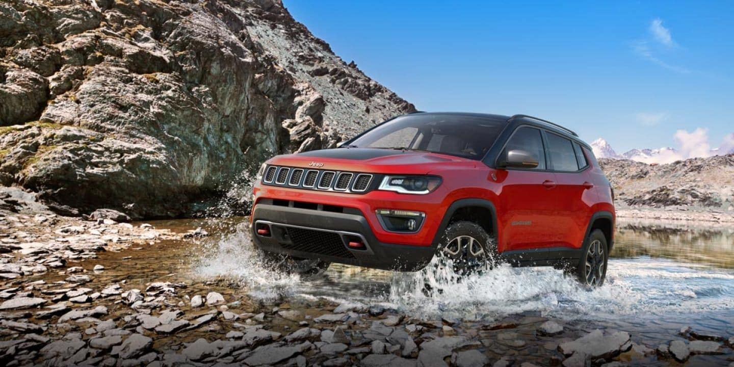 2019 Jeep Compass in red off roading