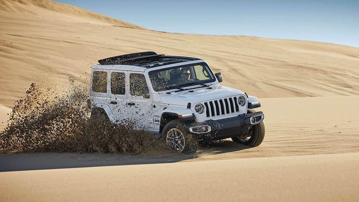 2019 Jeep Wrangler driving on sand