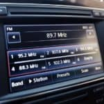 Infotainment car screen with radio station on