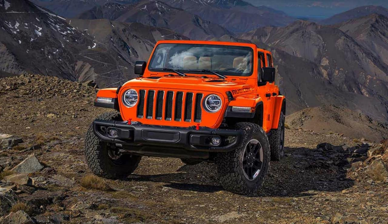 2019 Jeep Wrangler Rubicon in red on mountain terrain