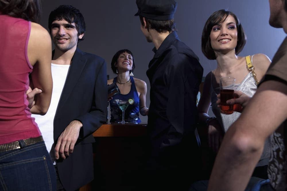 friends talking at a bar club